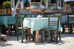 Empty Tables and Chairs on Sunny Restaurant Patio Stock Photo