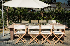 Empty tables, chairs and umbrellas in the garden for BBQ Party Royalty Free Stock Photos