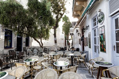 Empty tables in greek coffee shop Royalty Free Stock Image