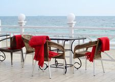 Empty tables at hotel restaraunt with red plaids on the beach. Empty tables at hotel restaraunt with red plaids on Black Sea coast,Odessa outdoors royalty free stock images