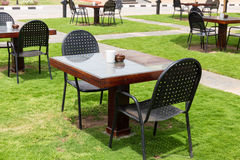 Empty tables on the lawn Stock Photography
