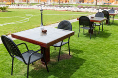 Empty tables on the lawn Stock Photos