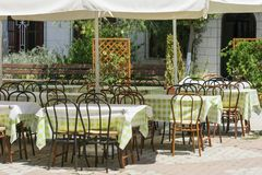 Empty tables in a Mediterranean restaurant Royalty Free Stock Photo