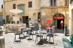Empty tables meeting point in little square fountain bar gelateria Royalty Free Stock Image