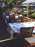Empty tables at an outdoor restaurant. Stock Photos