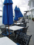 Empty Tables on a Rainy Day. A row of empty tables at a beachfront restaurant in Long Beach, California Royalty Free Stock Photos