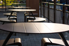 Empty tables of a street cafe at sunset Stock Image