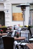 Empty tables of street cafes Stock Photo