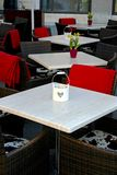 Street cafe. Empty tables on the street with flowers on them outside a cafe bar or restaurant Royalty Free Stock Photo