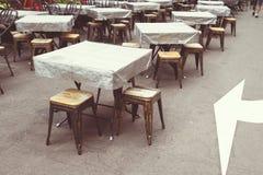 Empty tables street Stock Image