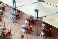 Empty tables in street restaurant Stock Image