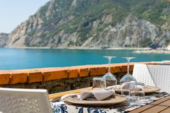Empty tables waiting for guests in sea resort. Luxurious restaurant above beach Stock Images