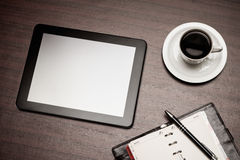 Empty tablet and a cup of coffee in office Stock Image