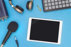 Empty tablet with DJ music producer equipment stock image