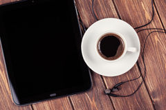 Empty tablet pc and a coffee Royalty Free Stock Images