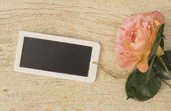 Empty tablet with rose Royalty Free Stock Photography