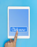 Empty tablet screen with Click now button Royalty Free Stock Photo