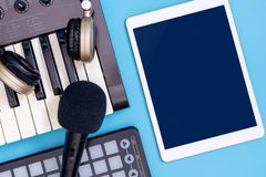 Empty tablet screen with music producer equipment stock image
