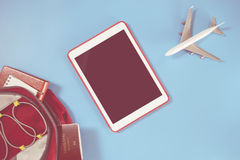 Empty tablet screen with travel backpacker objects Stock Image