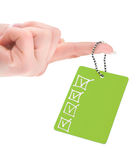 Empty tag with completed checklist. Female hand holding empty tag with completed checklist on white background Royalty Free Stock Image