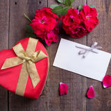 Empty tag,  fresh red roses  and gift box Royalty Free Stock Photo