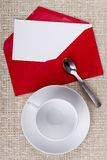 Empty tea cup and an envelope Stock Photo
