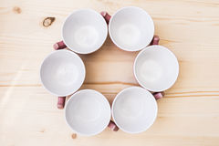 6 empty tea cup on table royalty free stock photography