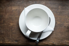 Empty tea cup on wood table Royalty Free Stock Photo