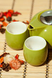 Empty tea cups with teapot. On table Royalty Free Stock Photo