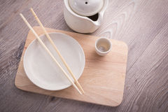 Empty tea drinking set. On old wood texture background Royalty Free Stock Photography