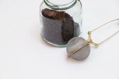 Empty tea infuser and a jar Royalty Free Stock Photo