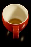 Empty teacup. Closeup of empty red teacup isolated on black background Royalty Free Stock Image
