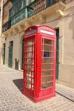 Telephone red booth in Marsaxlokk, Malta royalty free stock images