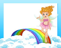 An empty template with a fairy above the rainbow Royalty Free Stock Image