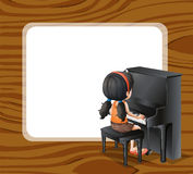 An empty template beside the girl playing with the piano Stock Photo