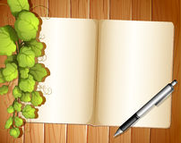 An empty template with plants and a ballpen Royalty Free Stock Photo