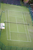 Empty tennis court. Seen from above. It has articifial grass Royalty Free Stock Photo