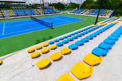 Empty tennis court chairs Stock Photography