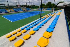 Empty tennis court chairs Royalty Free Stock Image