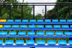 Empty tennis court chairs Stock Image