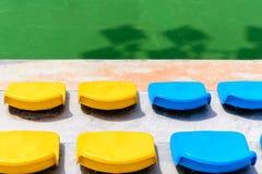 Empty tennis court chairs Stock Photo