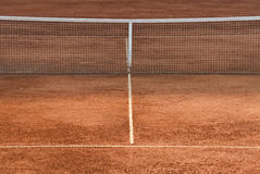 Empty tennis court. Part of a clay tennis court and the net Stock Photo