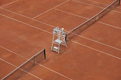 Empty tennis courts. Two empty tennis courts, referee's chair in the centre Royalty Free Stock Photography