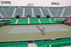 Empty tennis stadium in the afternoon with no people. Net, chair, bleachers, stands royalty free stock photography