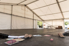 Empty tent with stage after a party Royalty Free Stock Images