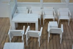 Empty terrace with white wooden furniture Royalty Free Stock Image
