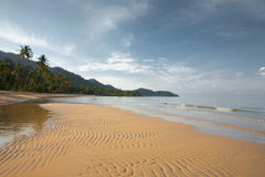 Empty Thai Tropical Beach H. A beautiful empty tropical beach with rippling waves of sand and water in Ko Chang, Thailand. Horizontal stock photography