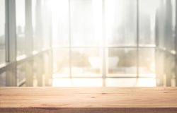 Free Empty The Top Of Wood Table With Blur Sunlight In Window Building Stock Images - 99381604