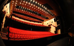 Empty theater. Red empty theater seat with backlighting Stock Photo