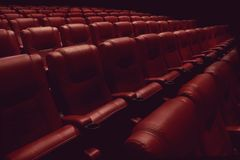 Empty theater auditorium or cinema with red seats Stock Photo